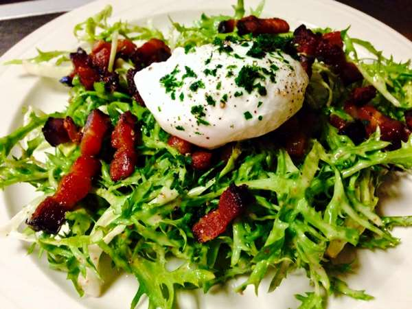 Ubiquitous Bistrot Salad: Frisée with farm fresh poached egg, bacon, and whole grain mustard vinaigrette.